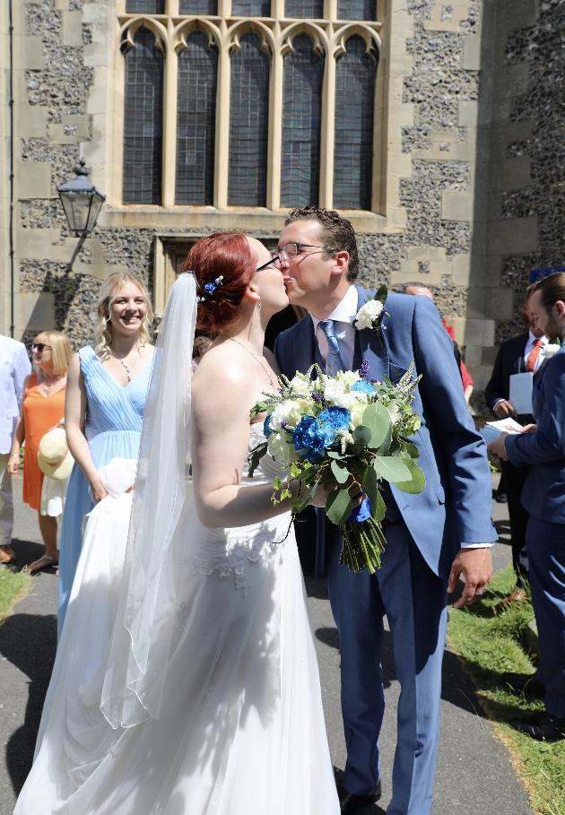 Couple kiss outside church