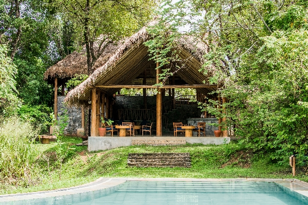al fresco hut restaurant with pool in front in the forest