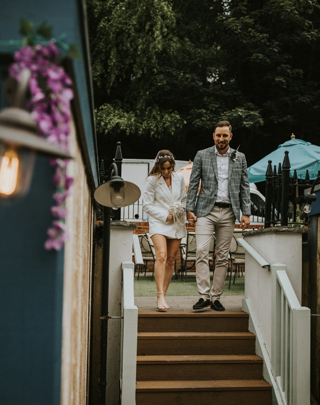 Couple arriving at reception